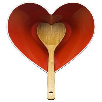 Red heart shaped stoneware with heart shaped wooden spoon.