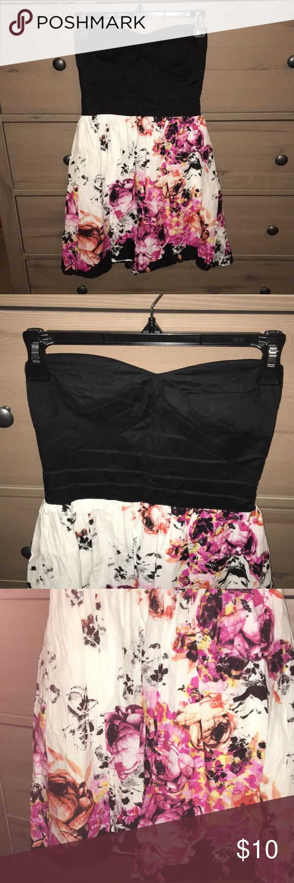 Strapless Flowered Junior Dress Junior size 3 Strapless Flowered Dress with black top with zip up back. Self is 100% Cotton, Contrast is 97% Cotton & 3% Spandex and lining is 100% Polyester. Trixxi Dresses Strapless
