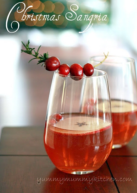 Christmas Sangria 1 bottle white wine 25 oz. sparkling cranberry juice 1 apple, thinly sliced 1/2 cup fresh cranberries 1 sprig rosemary (more for garnish, optional) Combine all ingredients in a large pitcher and refrigerate for one hour or until ready to use.
