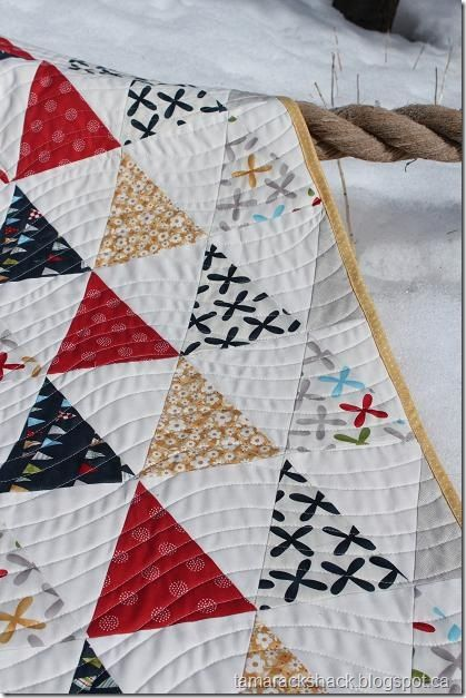 I sometimes forget how a simple triangle quilt can be something really special.  Reference this for future quilt.