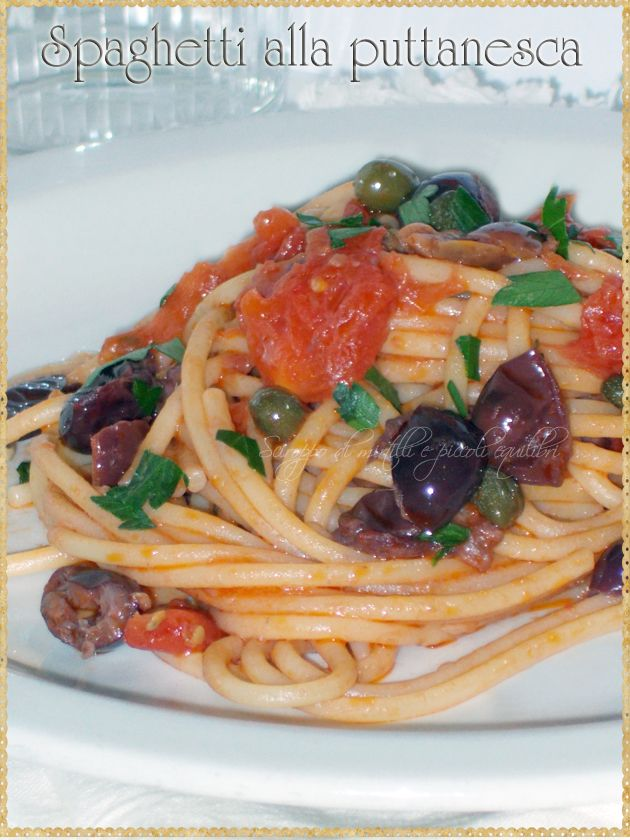 Spaghetti alla puttanesca (spaghetti, garlic, olive oil, tomatoes, olives, capers, anchovies, red pepper and parsley) #Pasta