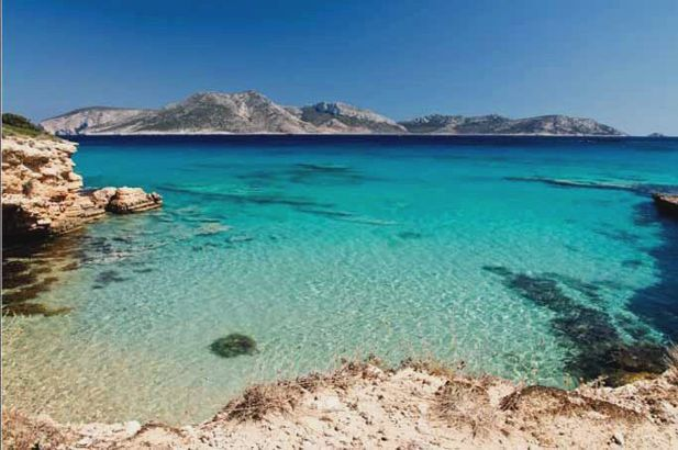 Koufonisia: astonishing little white sandy beaches, fox-red cliffs, bright blue lagoons, and sea caves. #FiveStarGreece #LuxuryVillas #HolidayMatchmakers