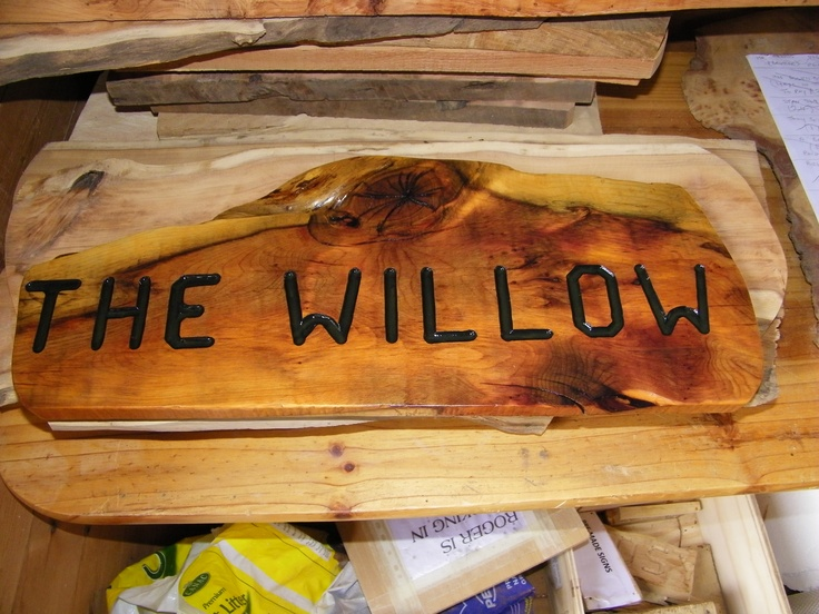 house sign made in yew wood