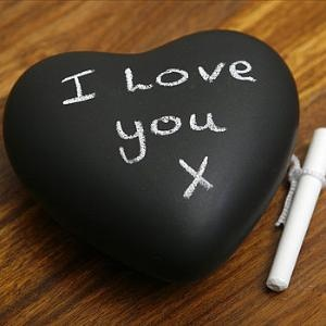 Rock painted with chalkboard paint = paperweight &/or message board
