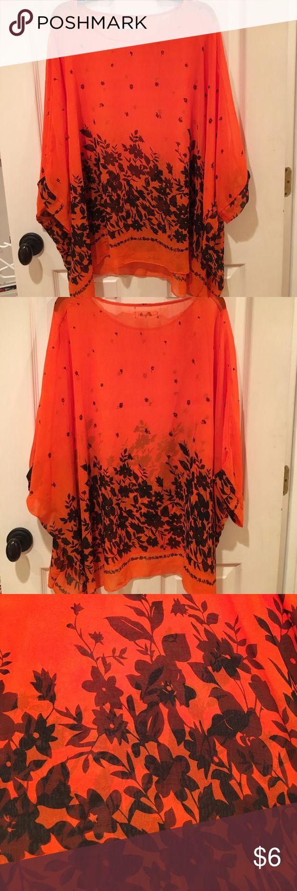 Bat wing sheer blouse. A sheer and flowing blouse with mid-length bat wing sleeves. Size Large. Tops Blouses