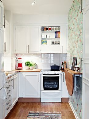 Small Kitchen Idea: A Collapsible Table Hanging on the Wall not this table, but something long narrow like it?