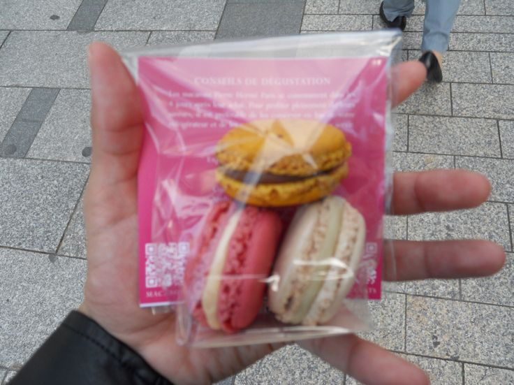 Macarons in Paris. Jasmine, Rose and passion fruit flavors from a shop on the Champs de elysee