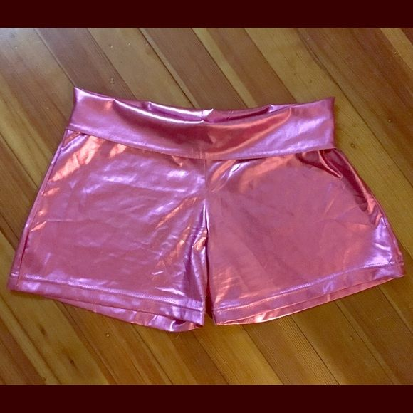 Brand new from Pat Fields! Pink dance shorts Brand new, never worn. Beautiful pink shiny dance shorts with fold over waist. Purchased new at Patricia Fields in New York. Longer than your usual booty/dance shorts. Great for yoga, festivals, club wear...size large but should fit a medium with hips and curves well. Shorts