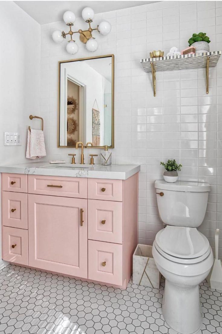 white and light pink bathroom // white subway tile // pink ...