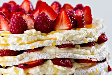 Layered fresh strawberry meringue cake recipe, NZ Woman's Weekly – When strawberries are in season, give this gorgeous dessert a go. Perfect for parties because you can make the meringue discs in advance, then assemble the cake just before eating. For more ideas on recipes using strawberries, lemon and other fruits around in spring-time, check out our Spring Fruits Collection. – foodhub.co.nz