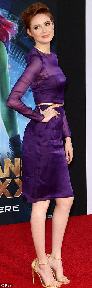 Karen Gillan  in a purple dress and high heels.