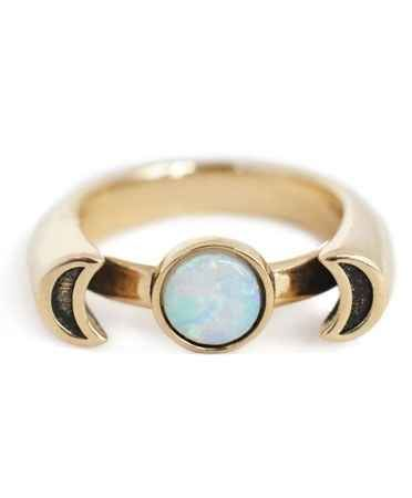 This brass ring with opal stone. | 65 Impossibly Beautiful Alternative Engagement Rings You'll Want To Say Yes To