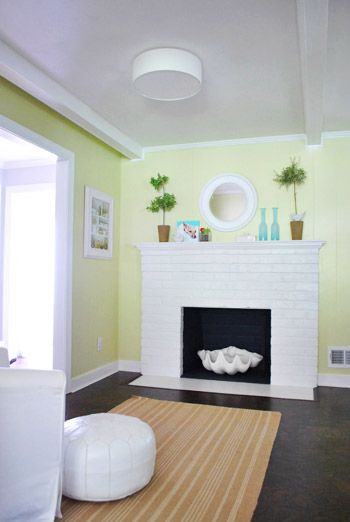 A Clean Flush Mounted Light Near The Fireplace