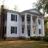 The Georgia Trust's 2014 Places in Peril: Nutwood Hall in Troup County, GA. Established in 1827, Troup County was primarily an agricultural center producing predominantly cotton and dairy. Few structures from Troup County's antebellum era in the Greek Revival style exist today, but houses such as the Flowers Newsome House and Nutwood Hall (pictured) provide excellent examples.