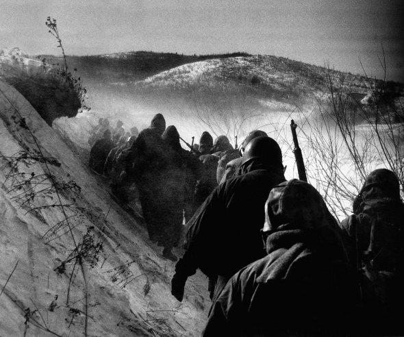 """Early in the Korean War, American Marines march through bitter cold down a canyon road they dubbed """"Nightmare Alley"""" during a grim retreat from the Chosin Reservoir. Originally published in the December 25, 1950, issue of LIFE.Bitter Cold, Korean Wars, Cold Wars, Life Magazine, American Marines, Nightmare Alley, Canyon Roads, David Douglas, Chosin Reservoir"""