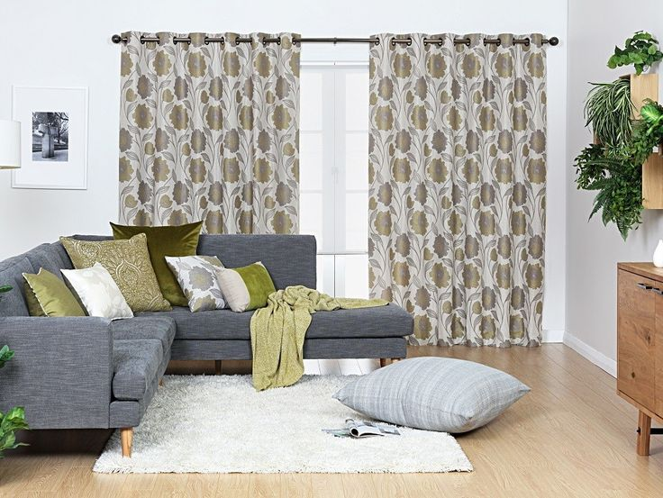 Fantasia Green Eyelet Curtains - A stunning floral design with a grey and green colour palette that will uplift and compliment any living space. The high quality polyester fabric will drape gracefully with its attached polyester lining.
