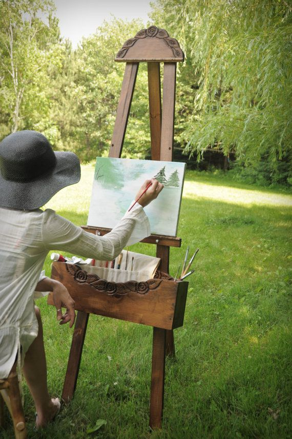 Мольберт и художник картинка