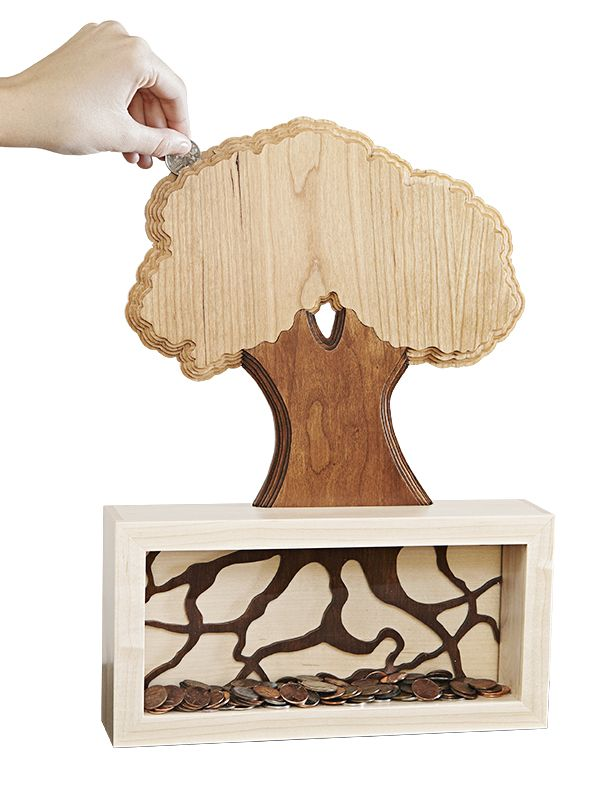 """Money Tree"" Coin Bank Woodworking Plan. Who says money doesn't grow on trees? Plant this scrollsawn coin bank in a fertile location and feed its roots often for a bountiful harvest. Featuring a three-dimensional ""growing"" design, this is one bank that makes saving fun. Featured in the November 2013 issue of WOOD."