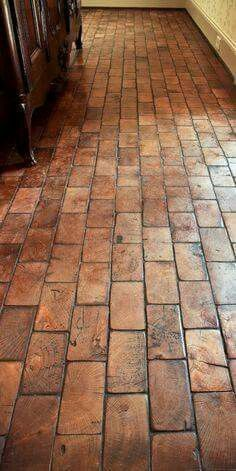 This is wood flooring made to look like brick.