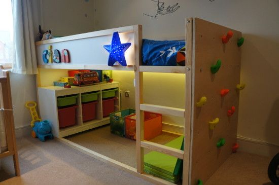 I built a first bed for my two year old son based on the Ikea Kura but featuring a climbing wall. The wall itself has evenly spaced holes drilled in it with T-Nuts installed so that I can make the rou