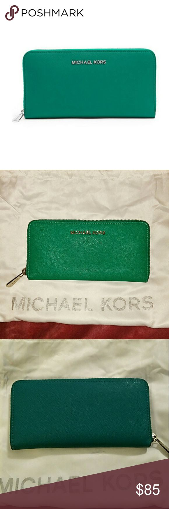 Michael kors jet set wallet Aqua color jet set wallet authentic, silver hardware. In new condition KORS Michael Kors Bags Wallets