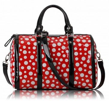 barrel handbag has been made from faux leather and finished in the glossy patent leather style