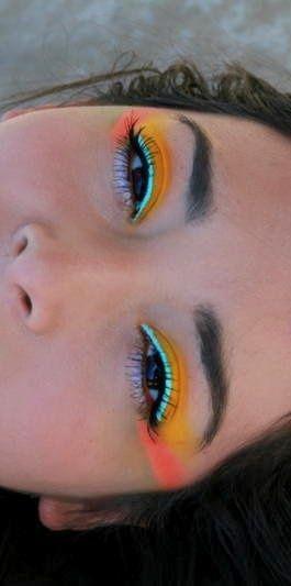 orange yellow eyes, bright turquoise eyeliner
