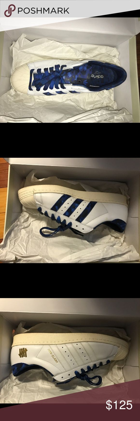 Bape x Undefeated x Adidas Superstar used Bape x undefeated x adidas collaboration white with blue camo on the insoles along with blue camo laces and white laces. Used in great condition 8/10 minor creasing no trades. Adidas Shoes Sneakers