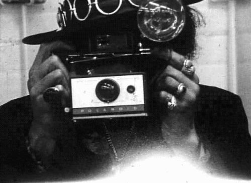 Jimmy Hendrix with a Polaroid