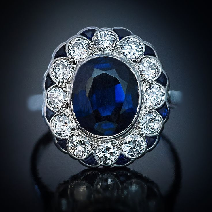 Just listed - a vintage engagement ring centered with a midnight blue sapphire surrounded by twelve bright white diamonds outlined by calibre cut sapphires #vintagering #vintagerings #sapphirering #engagementring #sapphireengagementring #vintageengagementring #vintagejewelry #vintagejewellery #clusterring #instaring #instarings # #ringsofinstagram #jewelryporn #statementjewelry #statementring #statementjewellery #ringoftheday #handcraftedjewelry #handmadejewelry #handmadejewellery…