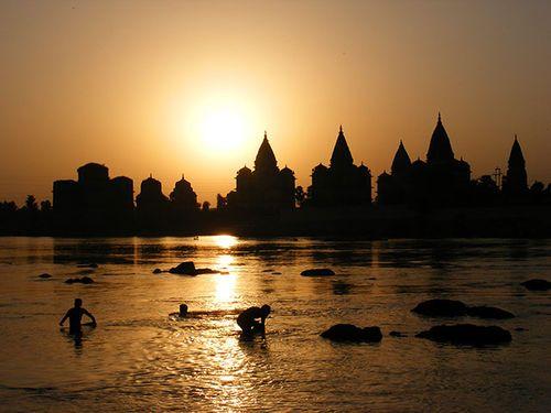 Sundown at The River Betwa, Orchha, India http://imagefun.tumblr.com/post/11308440061/the-river-betwa-in-orchha-india-sundown
