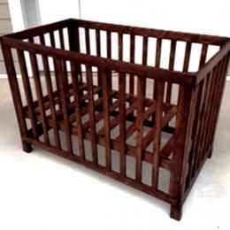 Wooden crib we could build ourselves for less than $100 with plans from thedesignconfidential.com.