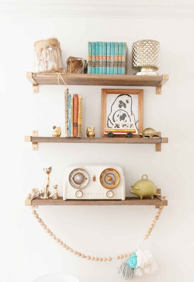 use reclaimed wood and ikea shelf brackets to add storage space to your walls