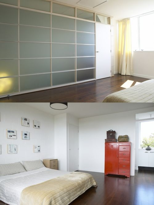 """Contemporary bedroom with translucent """"shoji' screen to stair."""