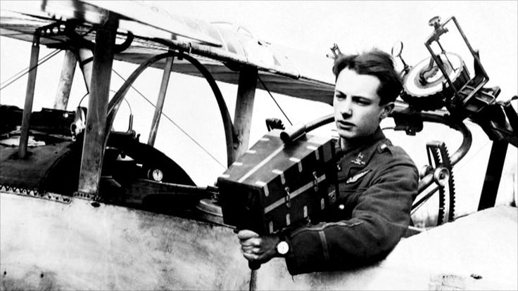 A Royal Flying Corps observer, holding an aerial camera. An observer had two jobs. He was required to take photos and make notes for reconnaissance work, and to act as a gunner, defending the machine from enemy fighters. A rail-mounted Lewis Gun is...