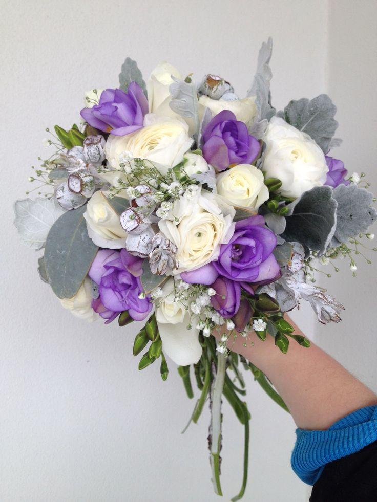 Bridal wedding bouquet of roses, ranunculus, babies breath ...