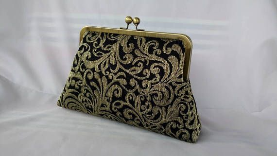 Check out this item in my Etsy shop https://www.etsy.com/listing/533168240/gold-black-lace-wedding-purse-mother-of