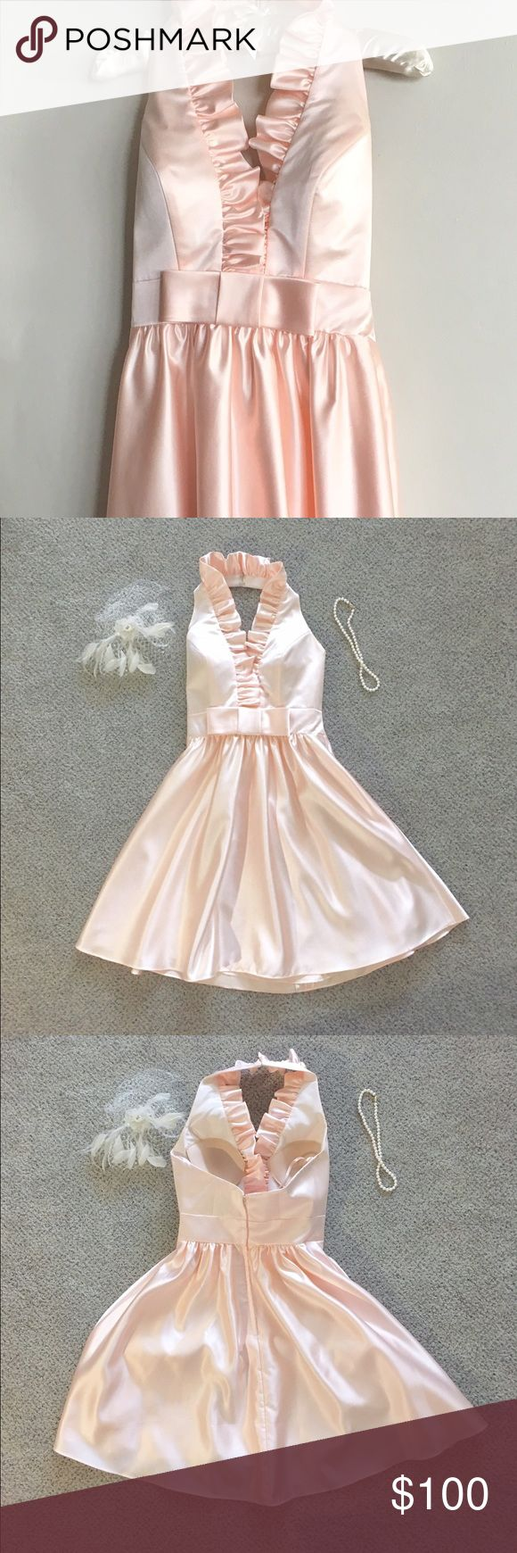"""Alfred Sung Ruffle Neck A-line Dress Perfect condition! Worn once. Ruffle Neck Short Alfred Sung Bridesmaid Dress in blush pink. Style no. D461. Halter top. Sewn in bra cups. Bow detail at waist. A-line, knee-length skirt. Zip back. Bust: 32"""", Waist: 27"""", Length: 35"""" (from neck halter to hem.) Size 4 but altered to fit size 2. Alfred Sung Dresses Wedding"""