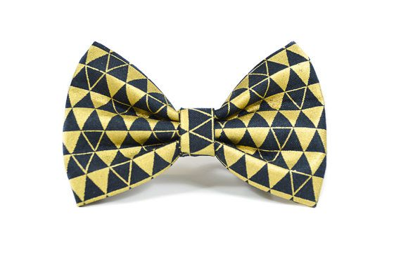 Metallic Gold Foil and Black Bow Tie - attaches to any collar up to a 1.5 width with two double-sided velcro tabs - lined with interfacing to maintain structure and shape - available in a 3 width, 4 width or 5 widths which can be chosen based on your preference. - pattern placement will vary slightly with each size  Hand wash and hand press as needed. Remove all collar accessories when pet is left unattended.  Made to order, ships in 1-2 weeks. Be sure to review our shop policies before…