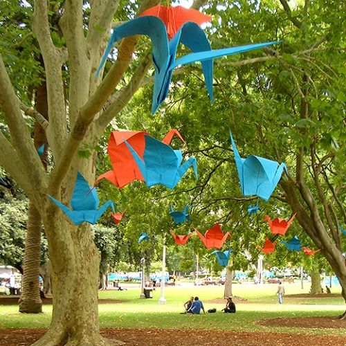 High-impact display marketing - Park Installation using colourful origami cranes - Plico Design