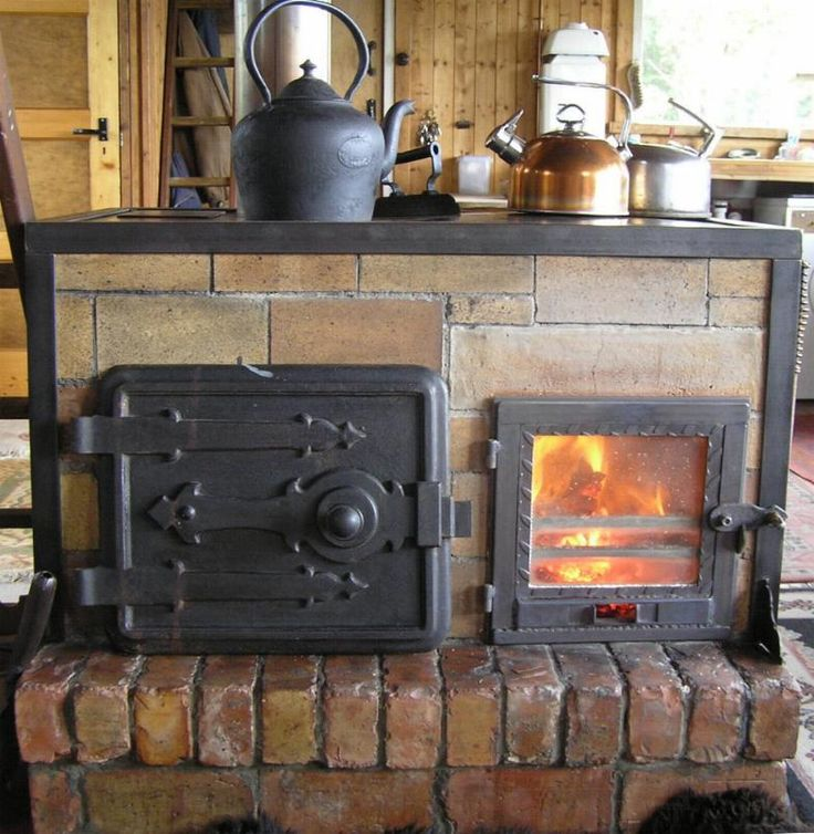 I recently stumbled across your great little forum and thought I'd share my stoves with you. The design is not classic rocket stove but includes elements of it. It's a horizontal front load, batch