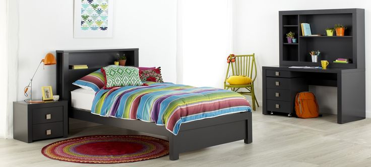 Taurus king single kids bed with bright multi-coloured striped linen and décor.