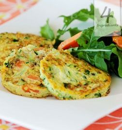 GF - Zucchini Fritters   Serves 2    2 eggs  1/4 red onion, grated  1/2 zucchini, grated  2 tbsp. grated carrot   Beat eggs and add remaining ingredients, season for taste. Heat a small non-stick frying pan over medium heat. Spoon 2 x 2 tbsp. of mixture into the pan, leaving room for spreading. Cook for 2 minutes each side.
