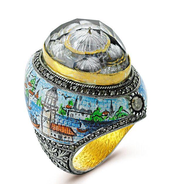 "Artist has poured his soul out to bring Istanbul live in its one of a kind ""ART IS IT"" collection which is studded with diamonds and Hand painted with KIZ KULESI on this side has mosaic effect and ottoman style carving on outskirts of ""ISTANBUL"" ring with 24k /925, beautiful DOMES hand carved inside the stone with reverse-intaglio technique which takes you LIVE in a Pasha era.   So why not WEAR YOUR ARTS !!!!!"