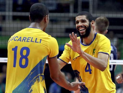 Brazil grabs men's volleyball gold, with Neymar watching:  August 21, 2016  -     Brazil's Wallace de Souza (4) celebrates with teammate Ricardo Lucarelli during a men's gold medal volleyball match at the 2016 Summer Olympics in Rio de Janeiro, Brazil, Sunday, Aug. 21, 2016. (AP Photo/Jeff Roberson)