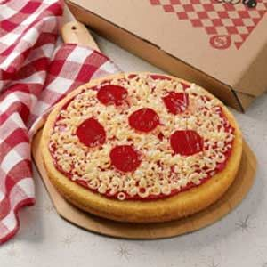 Pizza Cake Recipe from Taste of Home -- shared by Caroline Simzisko of Cordova, Tennessee  #April_Fools