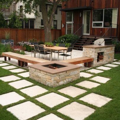 Contemporary home concrete poured stepping stones patio for Garden stepping stone designs