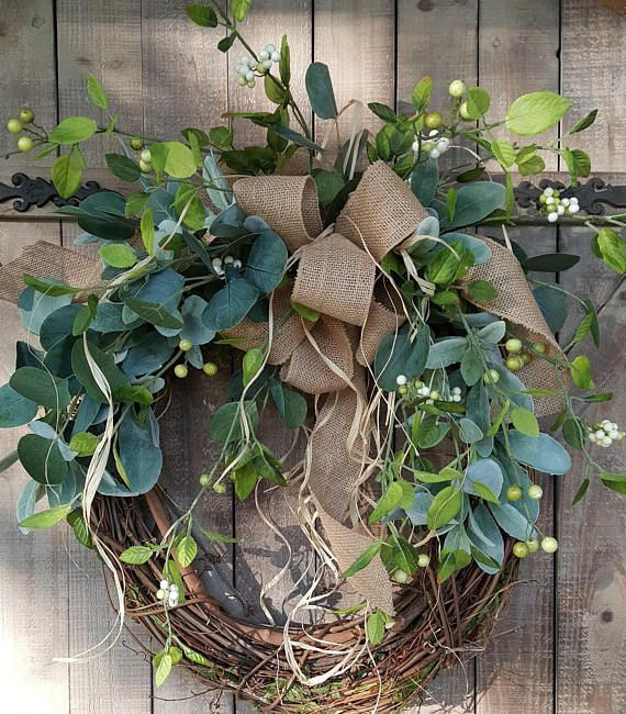 This beautiful burlap front door greenery wreath is the perfect simple accent for your door or interior. A beautiful mixture of green eucalyptus and lambs ear makes this wreath perfect all year round. Elegant enough to use in a wedding or for a bridal shower. A wired burlap ribbon