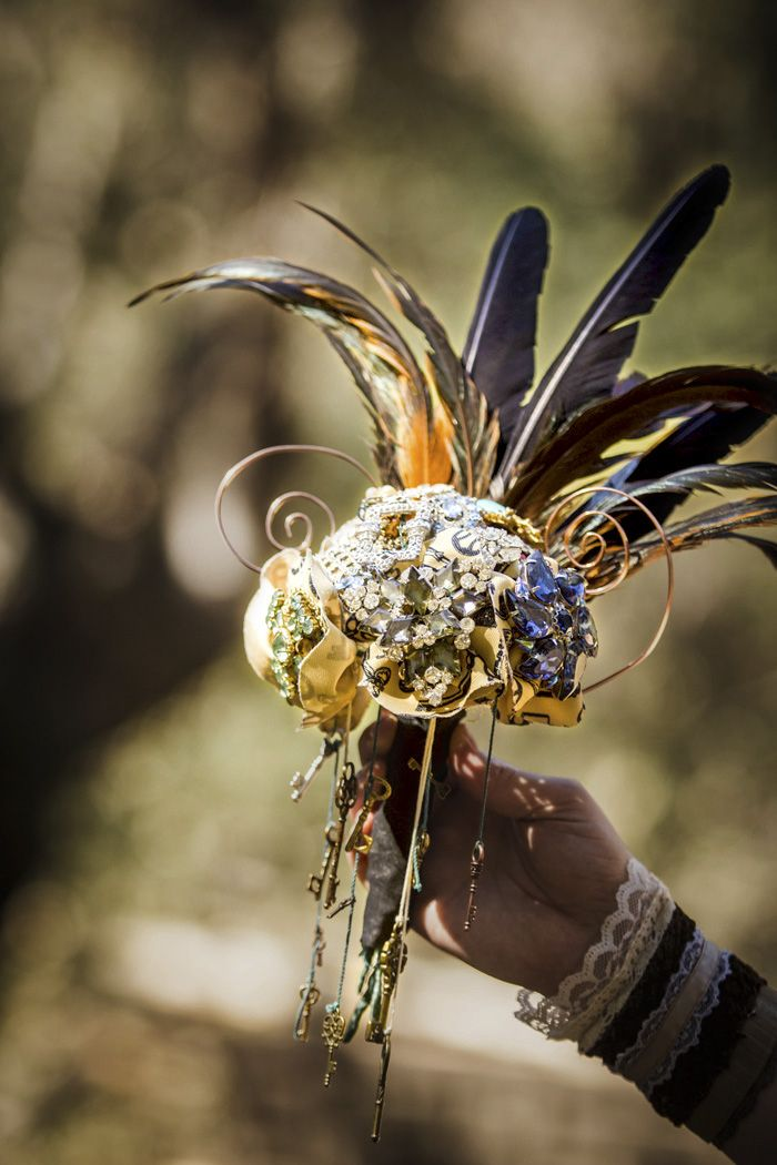 Incredible steampunk wedding bouquet with feathers!