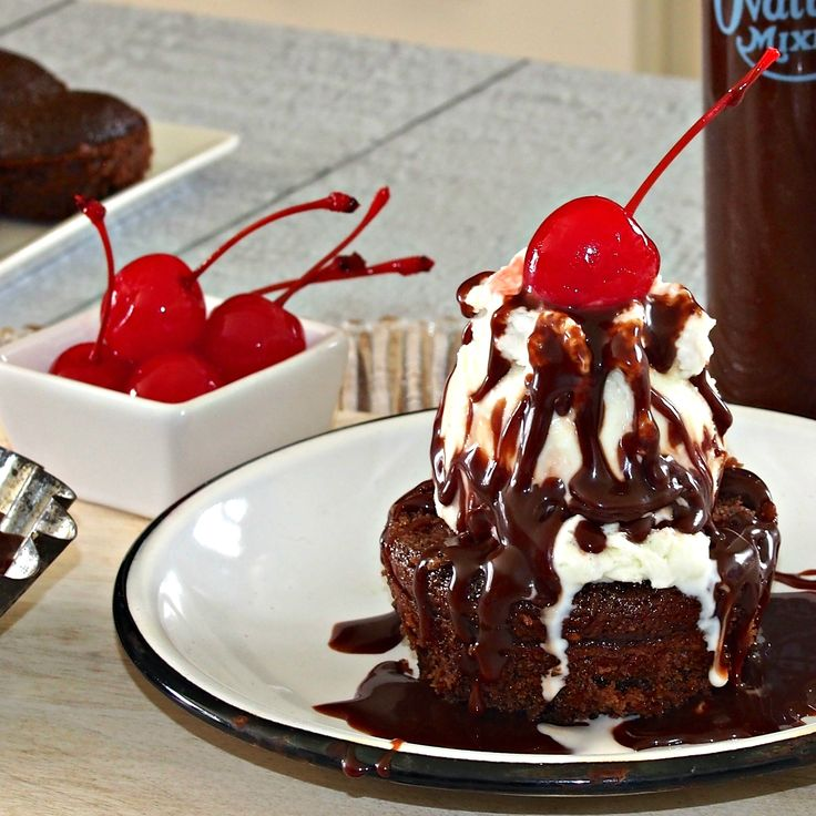 Hot Fudge Sundae Cupcakes -- Chocolate Cupcakes topped with Ice Cream, Whipped Cream, Hot Fudge, Nuts, and a Cherry